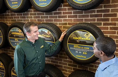Just Tires associate discussing the Goodyear Assurance TripleTred All-Season tire with customer