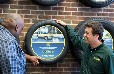 Just Tires associate discussing the Goodyear Eagle LS-2 tire with customer