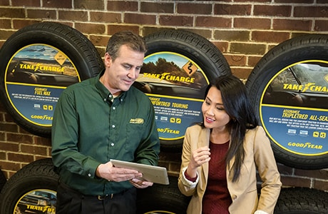 Just Tires associate reviewing tire options with customer